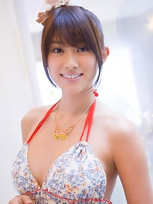 Mikie Hara Asian with big tits and sexy legs listens to the music