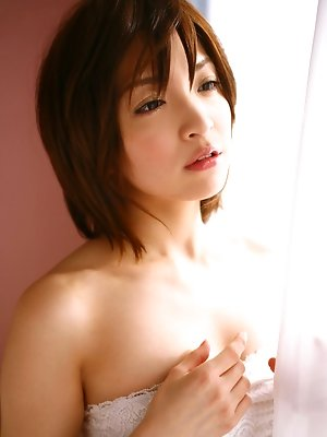 Ryoko Tanaka Asian exposes hot behind in red panty in her bed