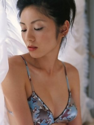 Sultry asian vixen boobs spill out of her black lace corset