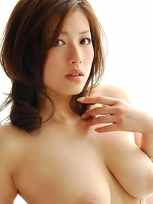 Japanese hottie opens nightie and shows off her tight hairy pussy