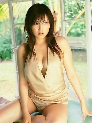 Plump asian beauty taking off her skimpy soft cream lingerie