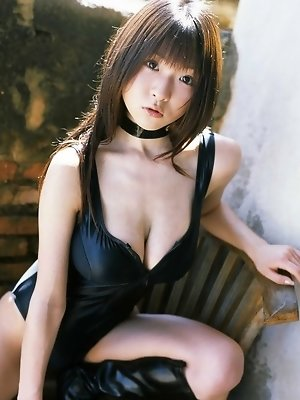 Stacked asian hottie displays her big busty tits in lingerie