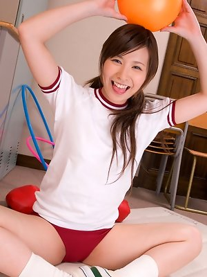 Iyo Hanaki Asian doll shows flexibility while playing with ball