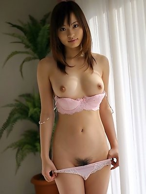 Naughty Asian babe teases the guys and shows off her hairy pussy