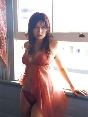 Seductive asian fox in a bikini with big soft round titties
