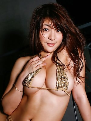 Sizzling hot gravure idol chick with big massive tits in a bikini